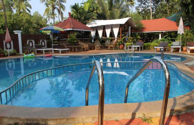 фотографии отеля Naga Cottages изображение №7