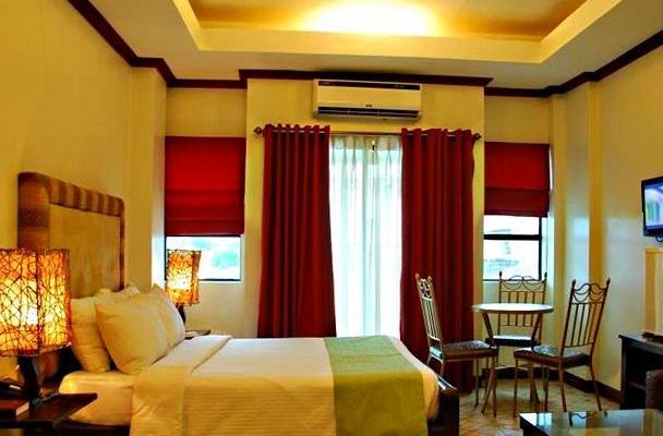 фотографии отеля Ecoland Suites изображение №3